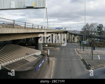 View south along the M8 motorway towards the Kingston Bridge from a deserted junction on the Clydeside expressway in in Glasgow city centre during the UK Coronavirus pandemic. This crossroads in Anderston is usually very busy with traffic at all times of day. - Stock Photo