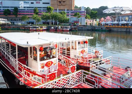 River cruise boats moored on Singapore River, Clarke Quay, Central Area, Singapore - Stock Photo