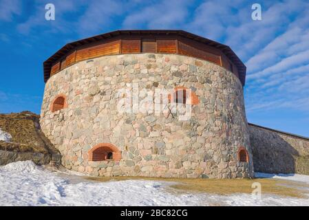 Ancient round tower of the prison fortress close up on a sunny March day. Hameenlinna Finland - Stock Photo