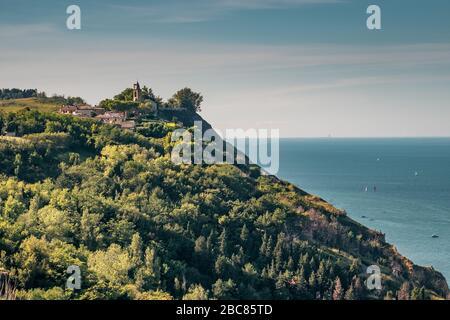 Fiorenzuola di Focara, amazing village on a cliff of the coast between Rimini and Pesaro. Pesaro and Urbino province, Marche, Italy. - Stock Photo