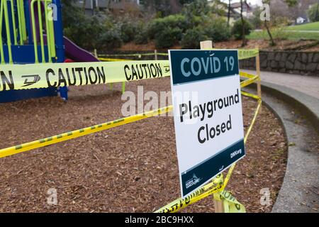 Deep Cove, Canada - April 1, 2020: View of sign Playground Closed due to COVID-19(Coronavirus) in Panorama Park - Stock Photo