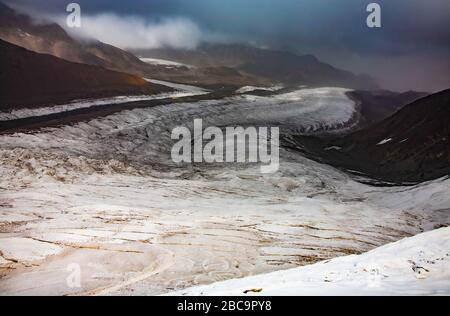 The Trans-Alay Range. Pamir Mountain System. Scenic landscape. Kyrgyz nature. Dirty snow in the valley. Cloudy. - Stock Photo