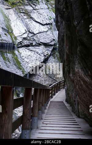 Germany, Bavaria, Upper Bavaria, Berchtesgaden, Wimbachklamm, footpath, wooden footbridge, rock face - Stock Photo