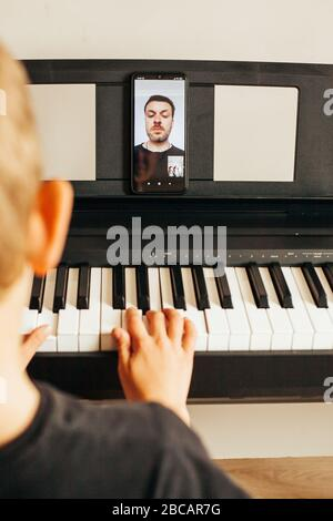 Child hands playing piano.Cllose-up piano, white and black keyboard