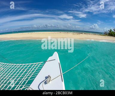 A catamaran is anchored at a small island off the coast of Puerto Rico. - Stock Photo