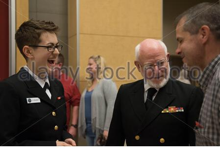 'SWARTZ CREEK, Mich. (April 22, 2017) Following a Sea Chanters chorus concert at the Swartz Creek Performing Arts Center, Musician 1st Class Amy Broadbent speaks with retired Senior Chief Hospital Corpsman Michael Hammond, who served as a Marine corpsman from 1962-1990. The Sea Chanters are on a 21-day tour of the midwestern United States connecting communities across the United States to their Navy. (U.S. Navy photo by Musician 1st Class Sarah Blecker/Released); 22 April 2017, 21:11; 170422-N-WV624-275; United States Navy Band from Washington, D.C., USA; ' - Stock Photo