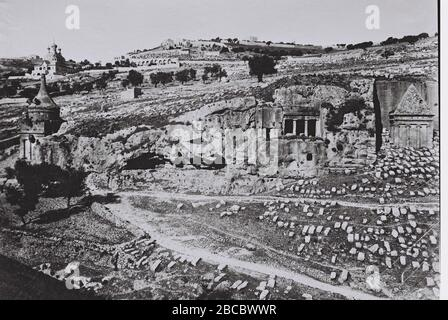 'Jerusalem Tomb of Absalom  English: ABSALOM'S PILLAR (LEFT) AND ZACHARIAH'S TOMB IN JERUSALEM, WITH THE MOUNT OF OLIVES IN BACKGROUND. (COURTESY OF AMERICAN COLONY) קבר זכריה בירושלים. ברקע, הר הזיתים.; 01/07/1912; This is available from National Photo Collection of Israel, Photography dept. Goverment Press Office (link), under the digital ID D826-110.This tag does not indicate the copyright status of the attached work. A normal copyright tag is still required. See Commons:Licensing for more information.   English| עברית| македонски| +/−; MATSON ERIC; ' - Stock Photo