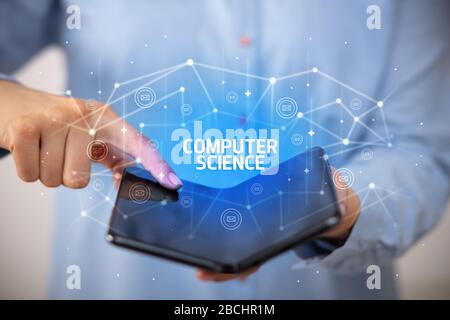 Businessman holding a foldable smartphone with COMPUTER SCIENCE inscription, new technology concept