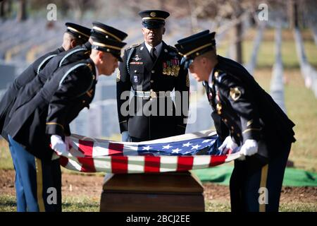 'Members of the U.S. Army 3d U.S. Infantry Regiment (The Old Guard) participate in the graveside service for U.S. Army Staff Sgt. James F. Moriarty in Section 60 of Arlington National Cemetery, Dec. 5, 2016, in Arlington, Va. Moriarty was one of three Special Forces soldiers from the 5th Special Forces Group (Airborne) who were killed in Jordan on Nov. 4. (U.S. Army photo by Rachel Larue/Arlington National Cemetery/released); 5 December 2016, 13:23; Graveside service for U.S. Army Staff Sgt. James F. Moriarty in Arlington National Cemetery; Arlington National Cemetery; ' - Stock Photo