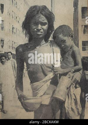 'English: Mother in shreds of clothing with child begging on the streets of Calcutta during the Bengal famine of 1943; 22 November 1944; Bengal Speaks edited by Kalyanee Bhattacharyee, Hind Kitabs, Bombay, 1944 (first edition). Scanned    from personal copy by Fowler&fowler (talk) 18:10, 21 April 2017 (UTC); Kalyani Bhattacharyee, and Sj. Manoj Sarbadhikar, Servants of Bengal Society, at 153/3N, Upper Circular Road, Calcutta; All Rights Reserved.  First edition 1944.  Printed by Manindra Chandra Dutta at Sabita Press, 18-B, Shamacharan De Street, Calcutta.  See also World Cat Catalog entry; ' - Stock Photo