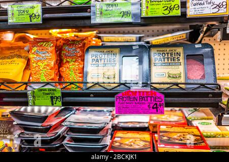 Reston, USA - January 24, 2020: Shopping store with vegan protein patties of plant-based burgers sold inside indoors of Trader Joe's shop in healthy s - Stock Photo