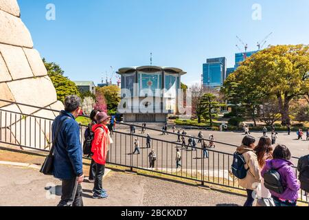 Tokyo, Japan - April 1, 2019: Imperial palace national gardens park with people at Edo period castle keep and Tokagakudo Imperial household agency dep - Stock Photo