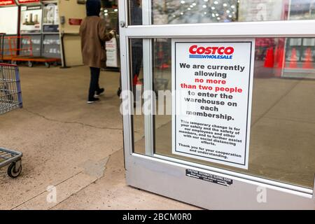 Sterling, USA - April 1, 2020: Costco warehouse club store social distancing sign with limit of two people to enter in shop per membership to prevent - Stock Photo
