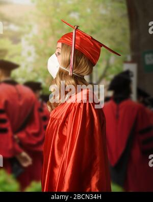 A college graduate is wearing a red robe and cape with a surgerical facial mask for the coronavirus fear on the class of 2020. Stock Photo