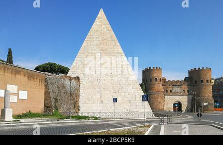 Following the covid-19 outbreak, the italian Government has decided for a massive curfew, leaving the Old Town totally deserted. Here Porta S.Paolo - Stock Photo