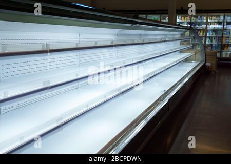 Supermarket with empty shelves for goods. Concept: sale and demand for purchases, deficit, excitement and epidemic, difficult economic situation. - Stock Photo