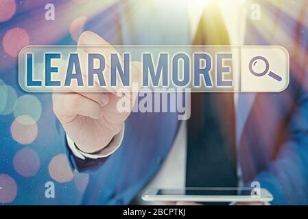 Word writing text Learn More. Business photo showcasing knowledge or skill acquired by instruction Considerable learning - Stock Photo