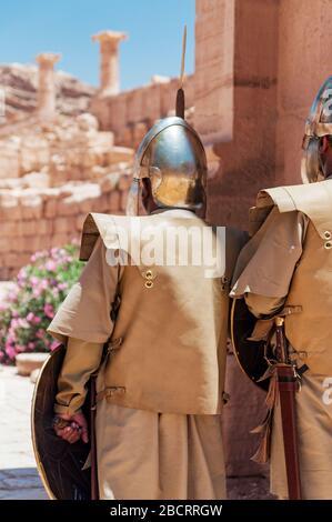 actors at the ruins of the roman great temple in ancient petra, jordan - Stock Photo