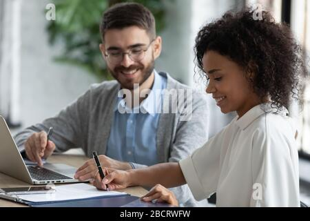Close up african american businesswoman signing partnership agreement concept.