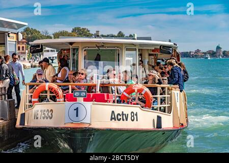Route No1 Vaporetto filled with passengers at Arsenale Vaporetto stop .Venice,Italy - Stock Photo