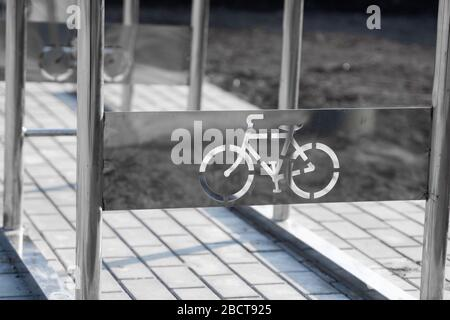 Empty bicycle parking with a sign of bicycle on a street.