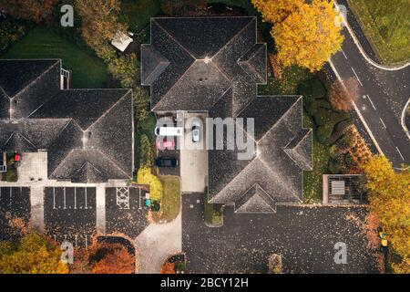 House roof tops at hazy autumnal morning in United Kingdom - top down drone point of view - Stock Photo