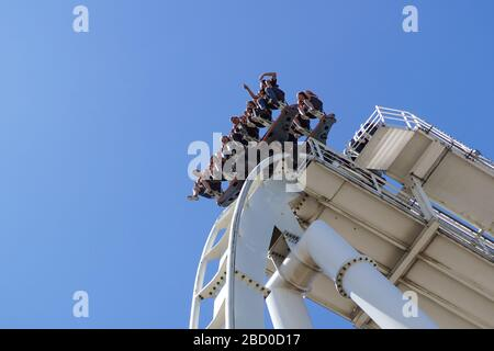 Gardaland, italy 20 june 2019 . Young people screaming during a ride at roller coaster Gardaland park . - Stock Photo