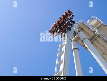Gardaland, italy 20 june 2019 . Young people screaming during a ride at roller coaster Gardaland park - Stock Photo