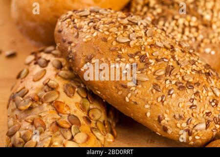 Selection of freshly baked gourmet rolls and loaves of bread - Stock Photo