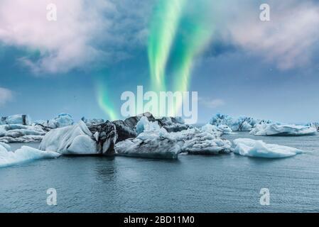 Northern lights aurora borealis over Jokulsarlon glacier ice lagoon in Iceland - Stock Photo