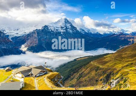 Hikers admiring the autumn landscape from elevated walkway, Cliff Walk by Tissot, First, Grindelwald, Bernese Alps, Canton of Bern, Switzerland