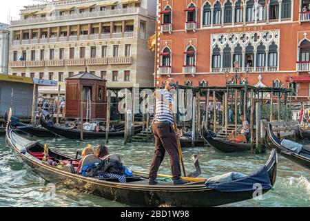 Tourists taking a Gondola ride outside The Hotel Danieli on The Grand Canal,Venice,Italy - Stock Photo