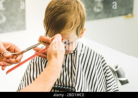 A little boy in a hairdressing salon