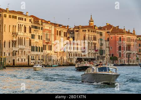 A Water taxi speeds along The Grand Canal followed by a route no 2 Vaporetto ,Venice,Italy - Stock Photo