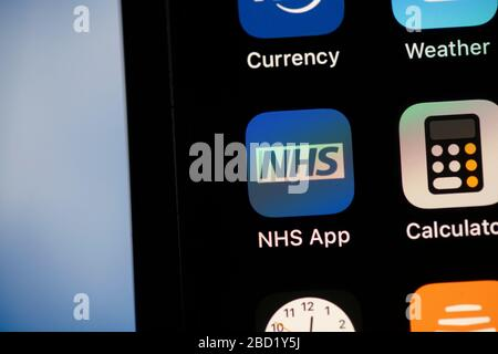 LONDON, UK - April 6th 2020: NHS National health service app on a smartphone - Stock Photo