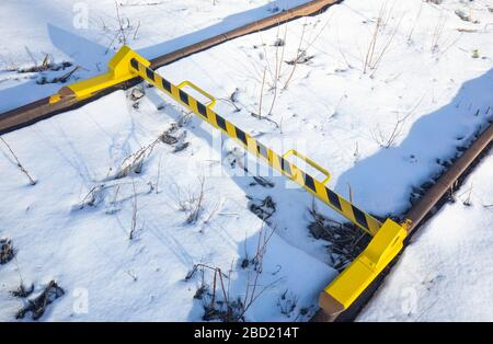 Removable skate rail stopper preventing train cars rolling over it at low speeds - Stock Photo