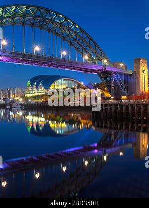 The Tyne Bridge & Sage Gateshead at night from Newcastle quayside, Newcastle upon Tyne, Tyne and Wear, England, United Kingdom - Stock Photo