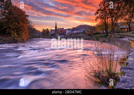 Sunrise over the town of Llangollen captured from the bank of the river Dee. - Stock Photo