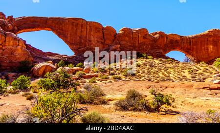 The South Window Arch in the Windows Section in the desert landscape of Arches National Park, Utah, United States