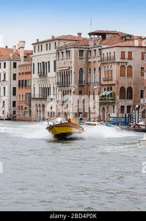 Blurred carabinieri police boat speeds along the Grand Canal of Venice, Italy - Stock Photo