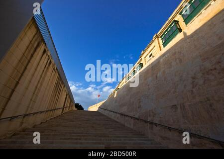 Stairway with lots of steps leading from the City Gate to the upper tier of the fortification of Valletta, Malta - Stock Photo