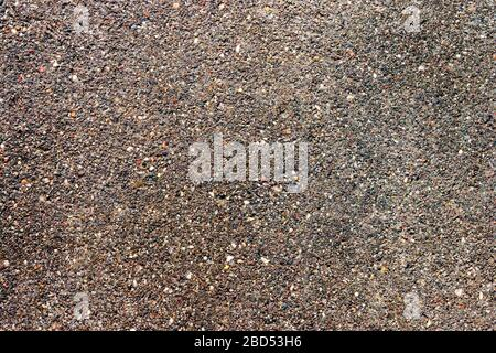 Abstract brown grey asphalt pavement road background. Roadway highway texture pattern backdrop.