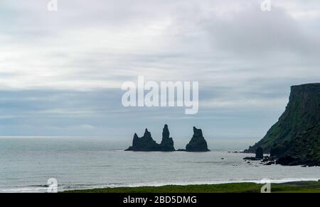 Reynisdrangar Trolls rocks near Vik i Myrdal - Iceland - Stock Photo