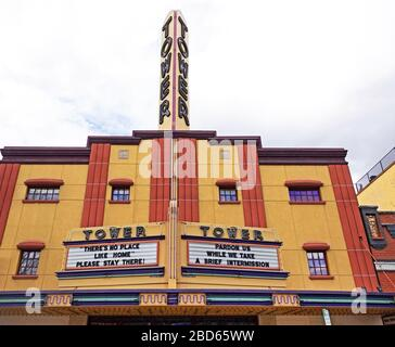 The event venue Tower Theater in Bend, Oregon, displaying 'Stay Home' signs during the Coronavirus pandemic of 2020. - Stock Photo