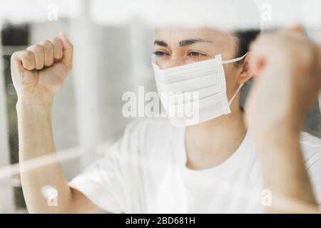 Angry patient in hospital coronavirus quarantine self isolation want to go outside. Pandemic Covid-19 control.