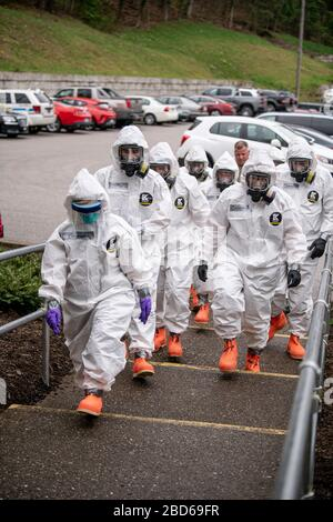 West Virginia Army National Guard soldiers arrive to assist medical staff with COVID-19, coronavirus testing at Eastbrook Center nursing home April 6, 2020 in Charleston, West Virginia. - Stock Photo