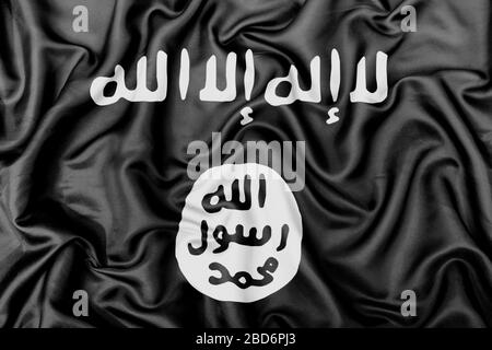 Islamic State of Iraq and the Levant flag silk fabric texture. - Stock Photo