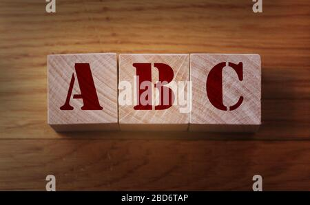Alphabet blocks ABC on wooden background. Elementary School education concept - Stock Photo