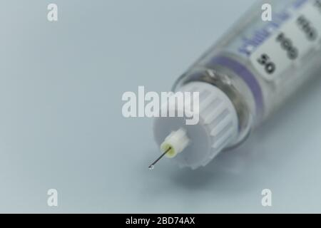 A close up of the needle of an insulin pen or insulin injection pen - Stock Photo
