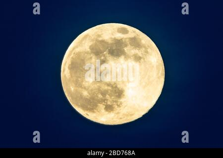 Edinburgh, Scotland, UK. 7 April 2020. Supermoon as seen from Calton Hill in Edinburgh. Tonight the full Moon is at perigee Ñ the closest point in the MoonÕs orbit to Earth, making it appear bigger and brighter in the sky. Pictured. Close up of the  Supermoon. Iain Masterton/Alamy Live News - Stock Photo